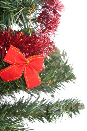 red bow on christmas tree isolated on white background photo
