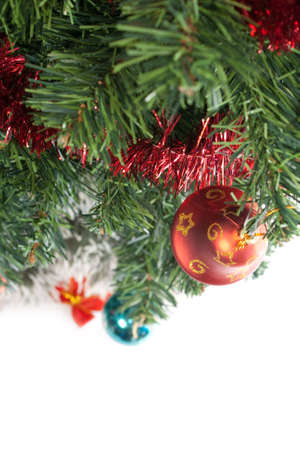 green christmas tree with decorations isolated on white background photo