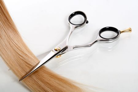 haircutting: lock of hair and scissors Stock Photo