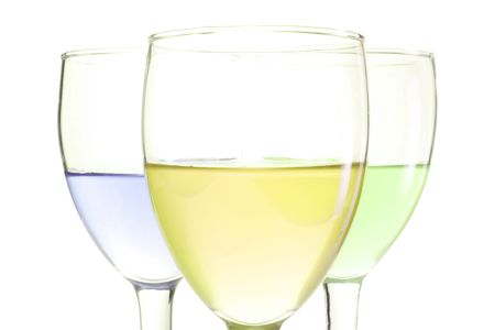 three glasses with green blue and yellow drinks Stock Photo - 5691875