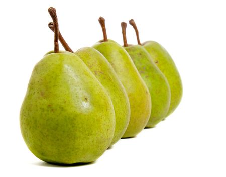 four pears in a row isolated on white background photo