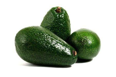 three avocados isolated on white background photo