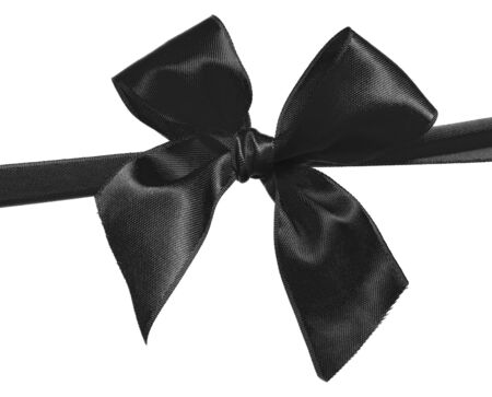 black ribbon and bow isolated on white background photo