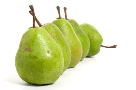 pears in a row isolated on white background photo