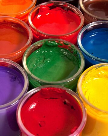 containers with different paints photo