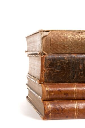 spines: stack of retro books isolated on white background Stock Photo