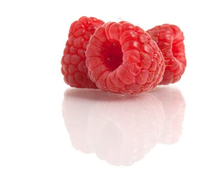 red raspberry with reflection isolated on white photo