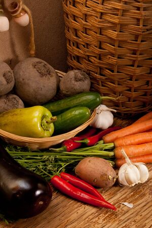 sorts: different sorts of vegetables on rural background