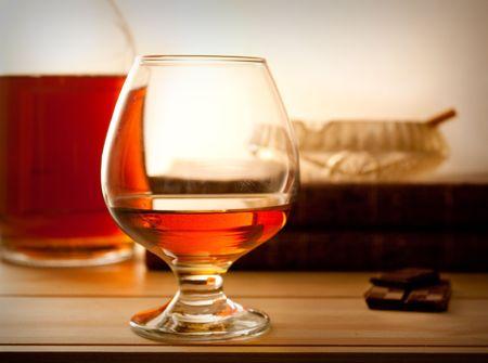 cognac with chockolate and ashtray Stockfoto