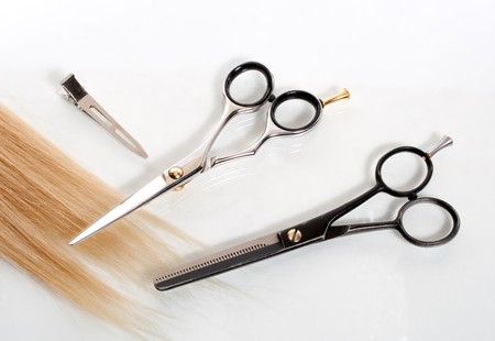 haircutting: two pairs of scissors and lock of hair
