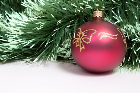 red christmas ball  on spruce background photo