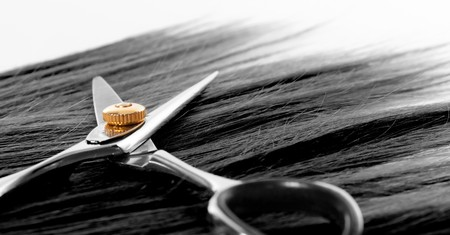 lock of hair and scissors. selective focus