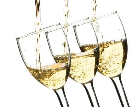 wine pouring into wine glasses Stockfoto