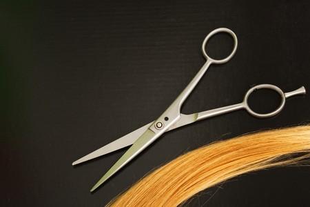 metal scissors on black background photo