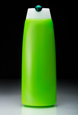 green shampoo bottle with reflection