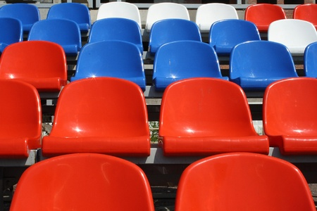 rows of plastic seats on stadium photo