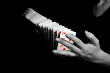 magician showing his trick on black background Stockfoto