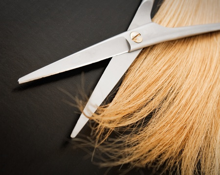Scissors and lock of hair. selective focus photo