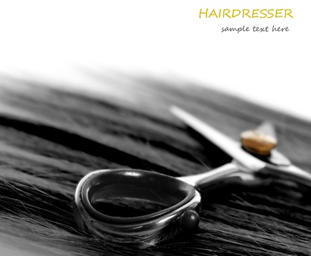 lock of hair and scissors. selective focus photo