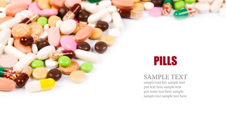 antibiotic pink pill: a lot of colorful pills background