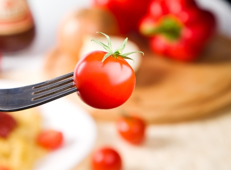 fork with cherry tomato on it photo
