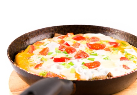 yelloow: fried eggs closup with vegetables