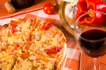sliced pizza and glass of red wine Stock Photo - 11658235