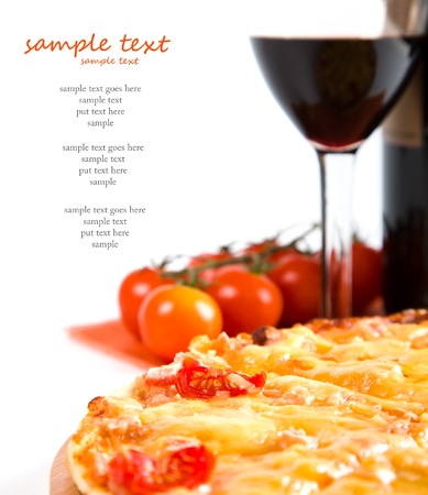 sliced pizza and glass of red wine photo