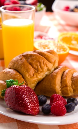 croissant with juice, jam and berries photo