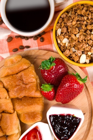 croissant with coffee, jam and berries photo