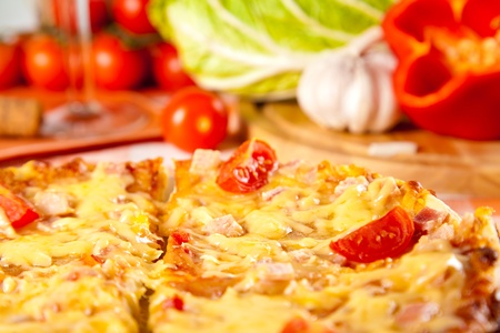 sliced pizza and fresh vegetables Stock Photo - 11814351