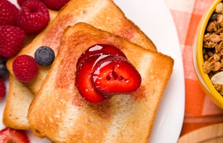 breakfast with toasts and berries on the table Stock Photo - 11814317