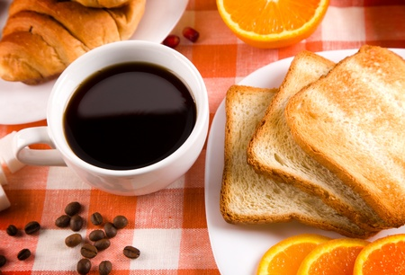 breakfast with toasts,  jam, coffee and fruits Stock Photo - 11882463