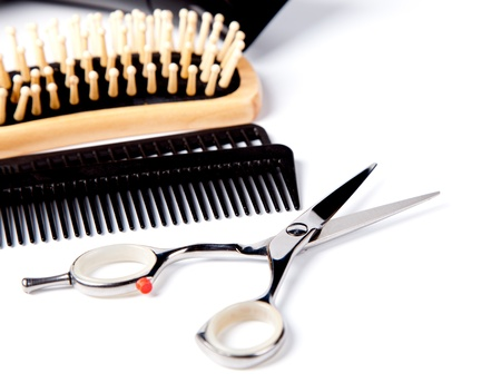 haircutting: haitdresser scissors,  combs and brush on white background
