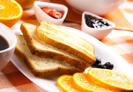 breakfast with toasts jam and fruits Stock Photo - 11939178
