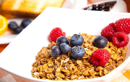 breakfast with muesli, toasts, jam and fruits Stock Photo - 11939151