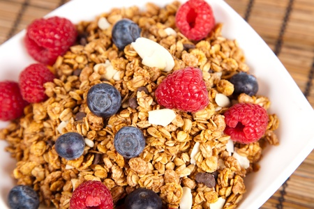 granola: plate of muesli with fresh berries. selective focus.