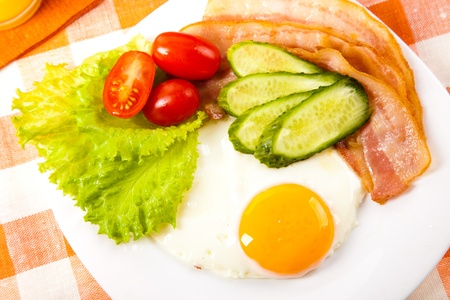 fried egg with fresh vegetables on plate Stock Photo - 11939185