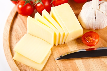cheese knife: sliced cheese on wooden board Stock Photo