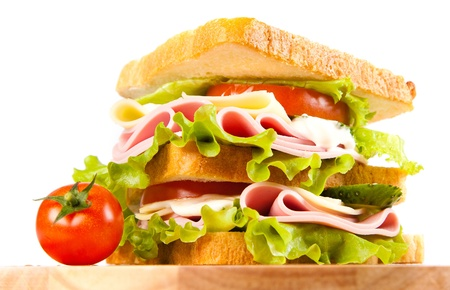 big sandwich with fresh vegetables on wooden board on white background Stock Photo - 12185452
