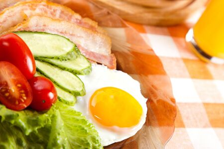 fried egg with fresh vegetables on plate photo