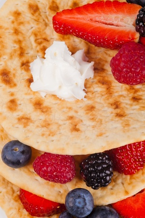 pancakes with fresh ripe berries and whipped craem photo