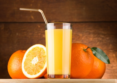 orange juice: glass of Orange juice and oranges