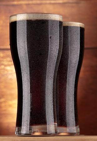 glasses of fresh dark beer