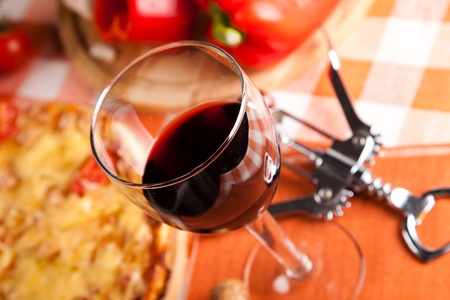 glass of red wine and food photo