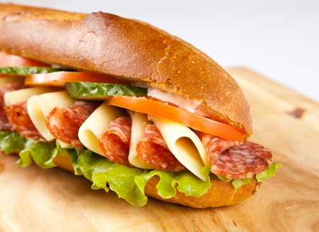 big sandwich with on wooden board photo