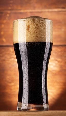 glass of fresh dark beer photo