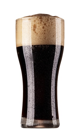 Frosty glass of dark beer isolated on a white background