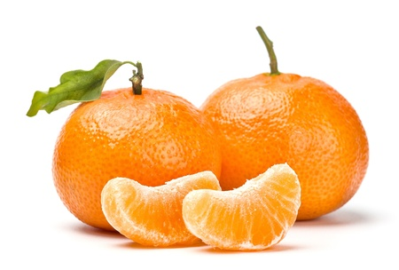 tangerines with leaves and segments isolated on white photo