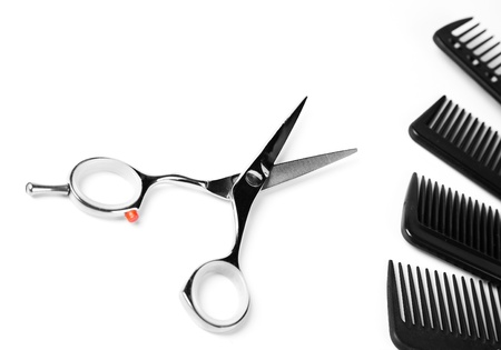 salon hair: scissors and combs on white Stock Photo